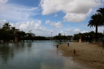 A man-made beach on the South bank of the Brisbane river, complete with palm trees and life guards.